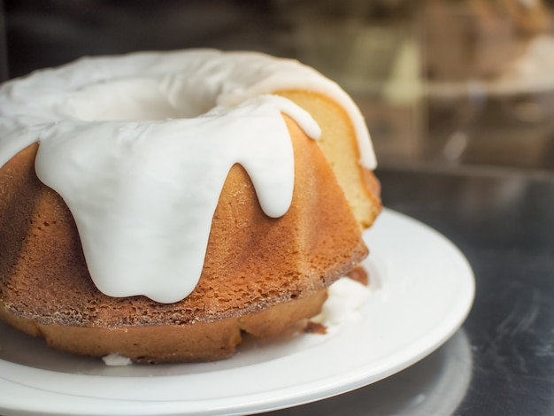 Traditional whole fresh baked gugelhupf with lilac sugar glaze.