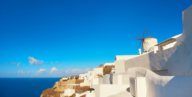 Traditional windmill in oia village, santorini, greece, text space