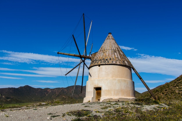 Traditional windmill of san jose, province of almeria, windmill traditional in spain, windmill under blue sky