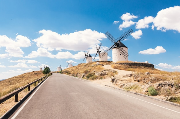 Traditional windmills in la mancha, spain. blue sky background.
