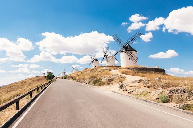 Traditional windmills in la mancha, spain. blue sky background.