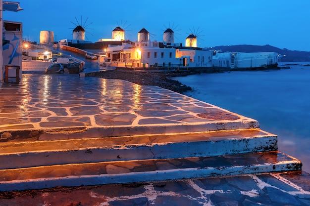 Traditional windmills at sunrise, santorini, greece