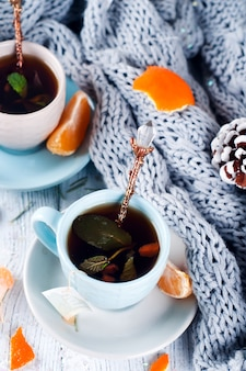 Traditional winter beverage tea with mint and tangerine.