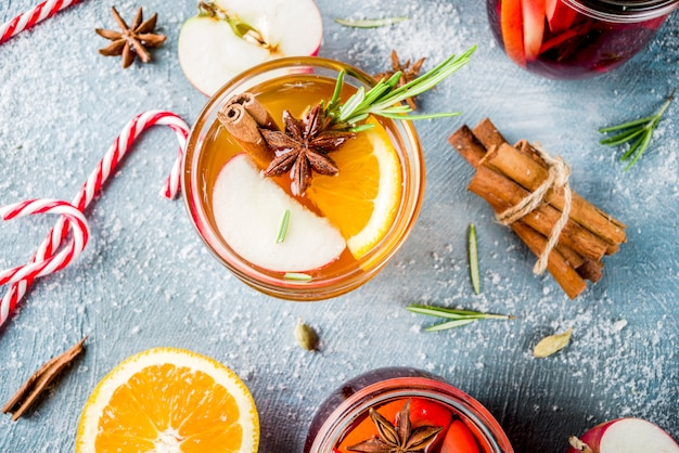 Traditional winter drinks, white and red mulled wine cocktail,  with white and red wine