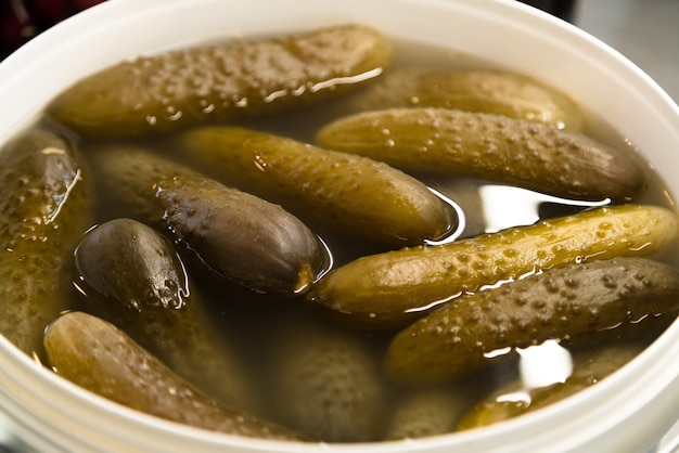 Traditionally pickled cucumbers in the bucket in it's own brine.