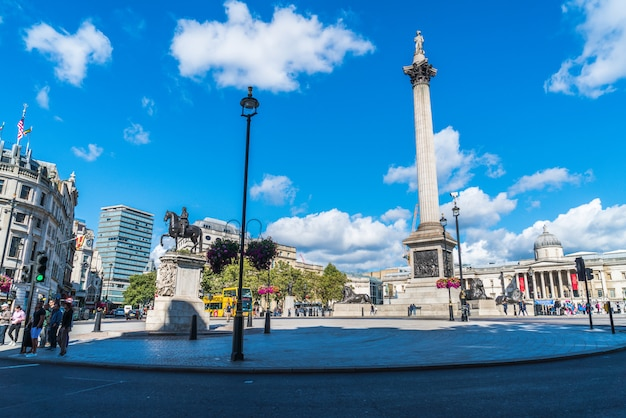 Trafalgar square is a public space and tourist attraction in central london. Premium Photo