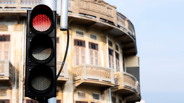 Traffi  lights with an old antique building