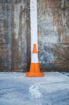 Traffic cone against wall