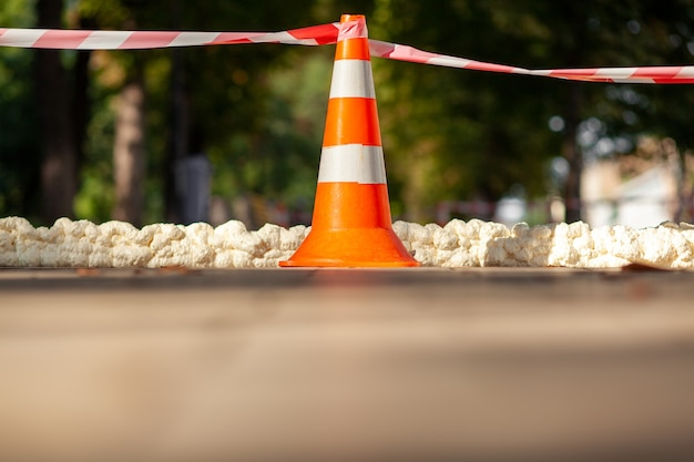Traffic cone with red white caution tape