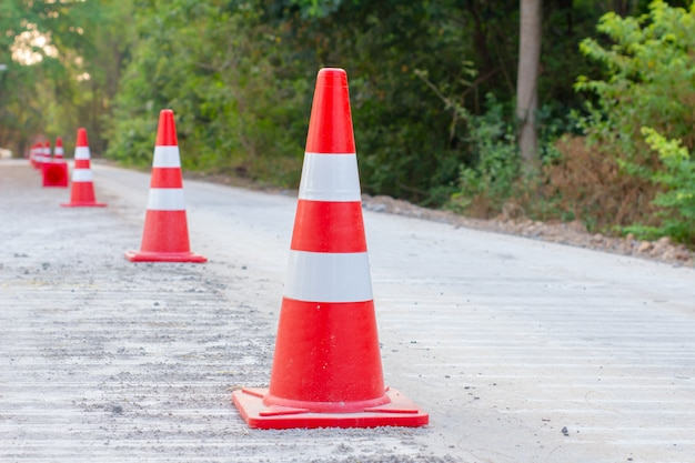 Traffic cones are placed on roads that are under construction.