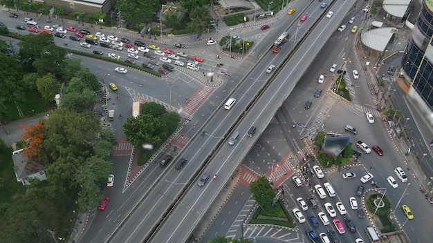 Traffic on crossroad. from above cars and motorcycles on intersection, street of bangkok, thailand.
