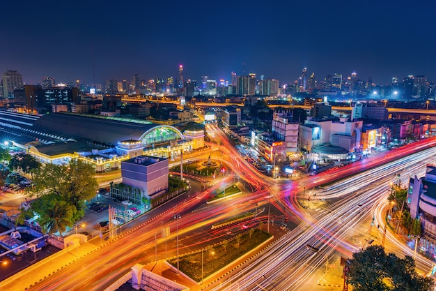 Traffic at hua lamphong intersection and hua lamphong railway station at night in bangkok