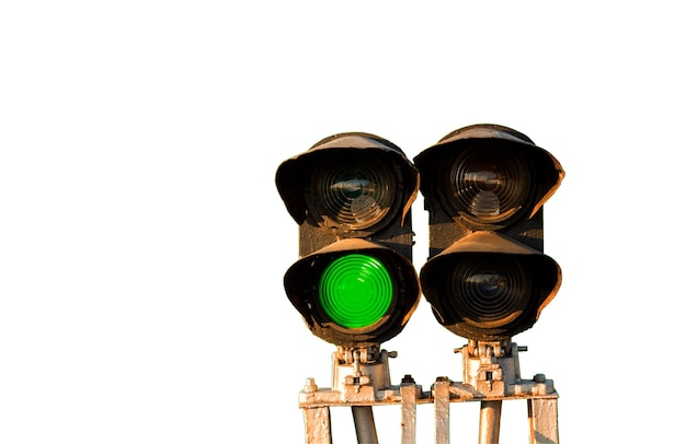 Traffic light shows green signal on railway isolated on white background