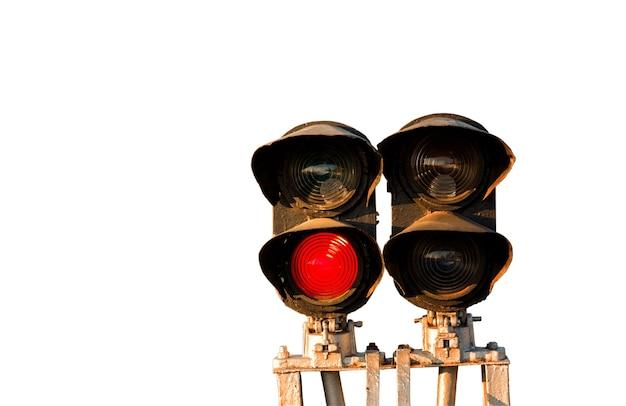 信号は白い背景で隔離の鉄道の赤い信号を示しています