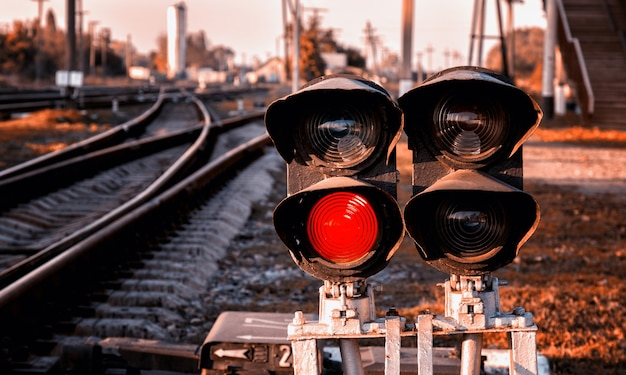 Traffic light shows red signal on railway ukrainian railways