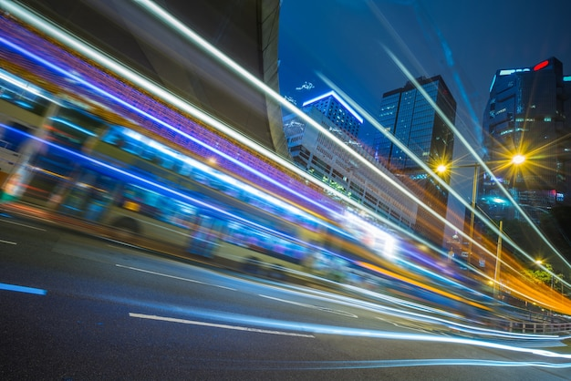 Traffic light trails in downtown Free Photo