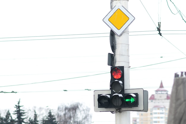 A traffic light with a burning red signal