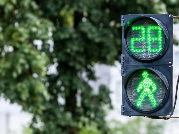 Traffic light with green light and timer on blurred background. the traffic light signals that traffic is allowed