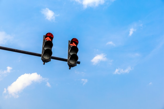Traffic light with red color on blue sky background