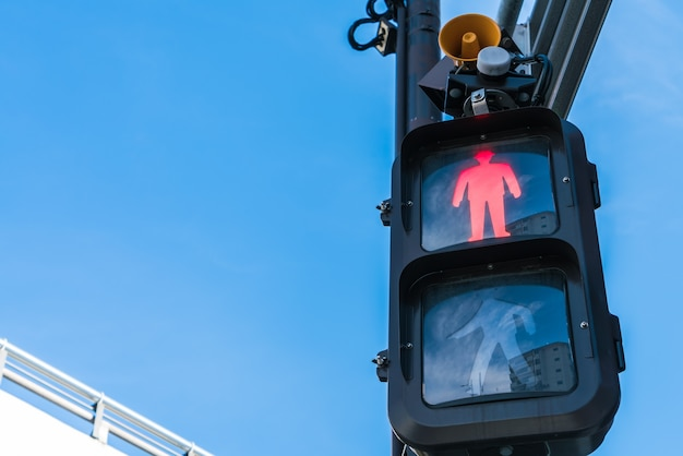 Traffic light with red sign for walkers to stop  .