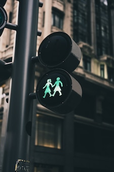Traffic lights of a city with lesbian figures