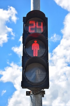 At traffic lights for pedestrians, a prohibitive red light is on and the seconds are counted until the start of movement