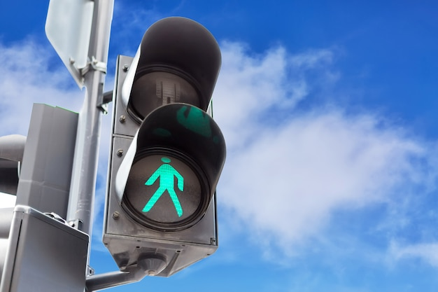Traffic lights with the green light lit for pedestrians