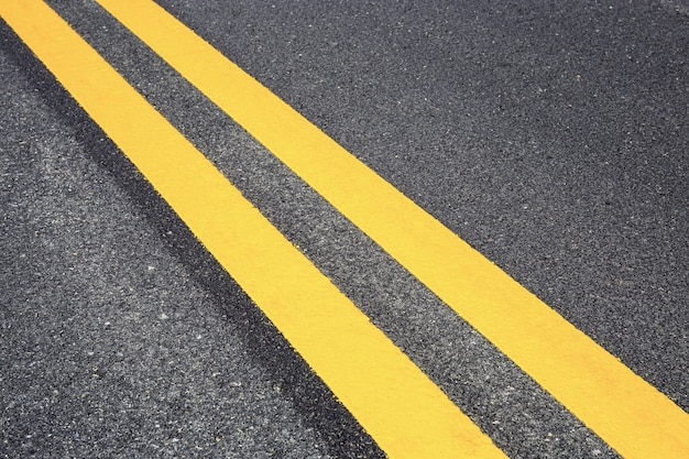Traffic line on road with texture background.
