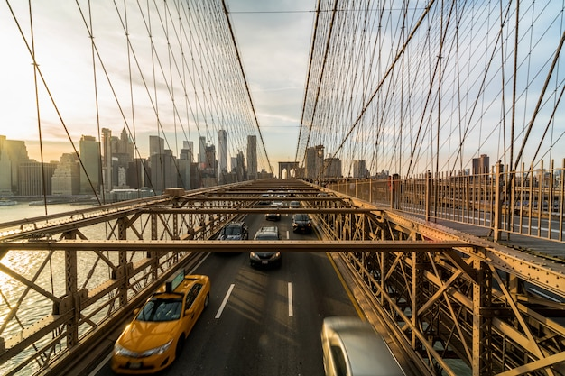 Traffic in rush hour after working day on the brooklyn bridge over new york cityscape