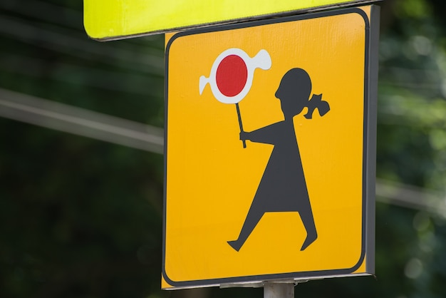 Traffic sign attention children in poland. girl with candy. close up.