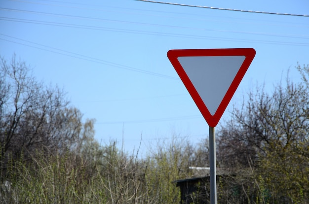 Traffic sign in the form of a white triangle. give way