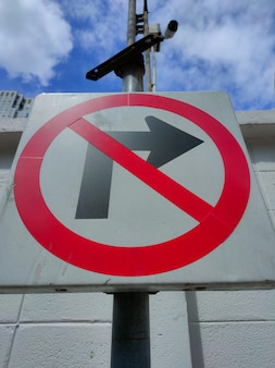 Traffic sign warning do not turn right installed on city roads.