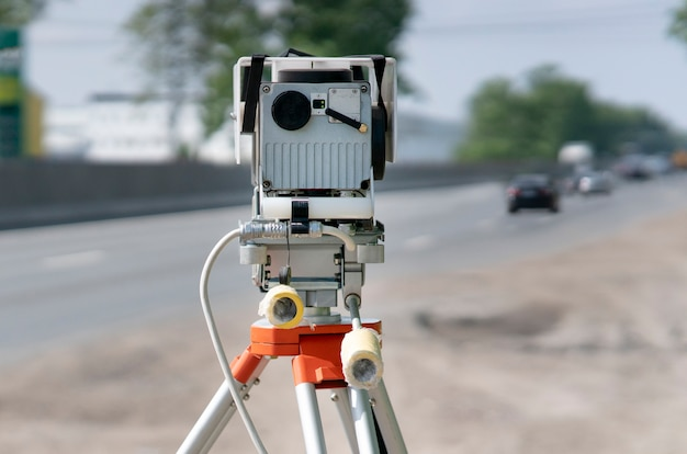 Traffic speed control camera radar installed by side of the road video camera is recording