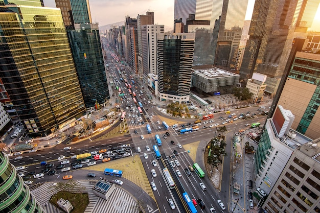 Traffic speeds through an intersection in gangnam, seoul in south korea