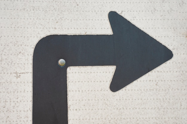 Traffic turn arrow sign and thumbtack