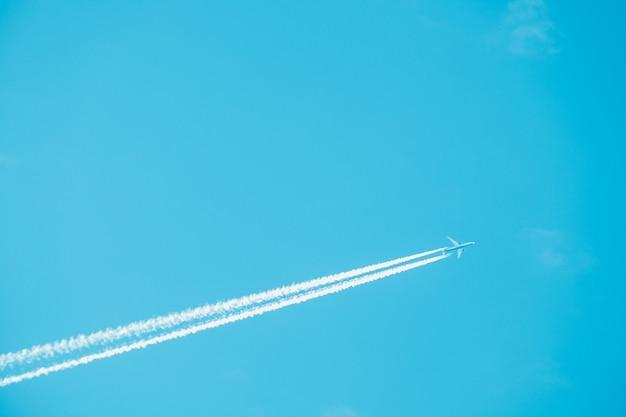 Trail of jet plane on blue sky