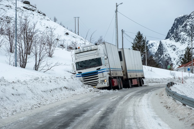 Trailer truck accident slippery on snow pavement