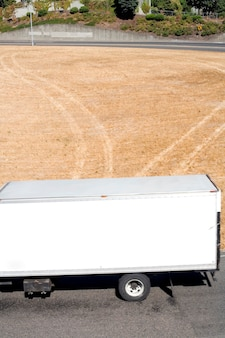 Trailer with tracks in grass