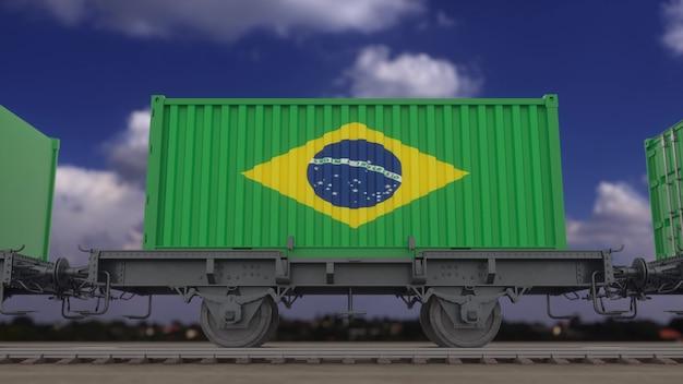 ブラジルの旗を掲げた列車とコンテナ。鉄道輸送。 3dレンダリング。