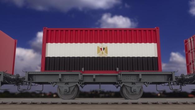 이집트 국기가 있는 기차와 컨테이너. 철도 운송. 3d 렌더링.