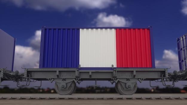 フランスの旗を掲げた列車とコンテナ。鉄道輸送。 3dレンダリング。