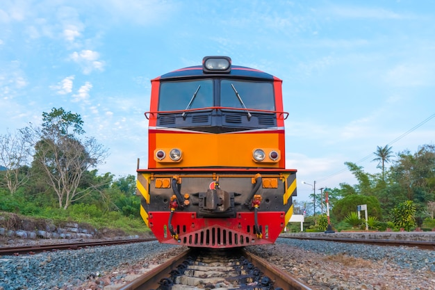 Train diesel electric locomotives on the tracks in station of thailand with blue sky.