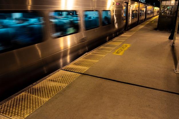 Train in motion near station