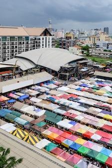 Train night market ratchada (talad rot fai) very famous shopping street food in bangkok, thailand