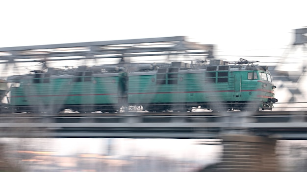 The train passes through the railway bridge at high speed. heavy industry, freight.