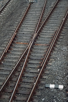 Train railroad tracks in the street in the station