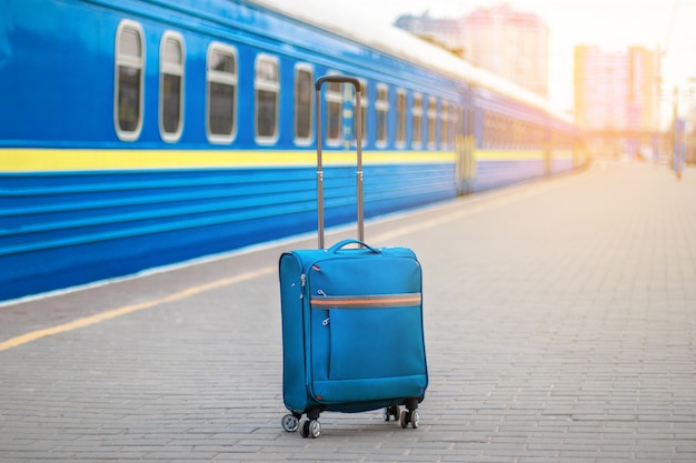 Train station and suitcase on the platform.
