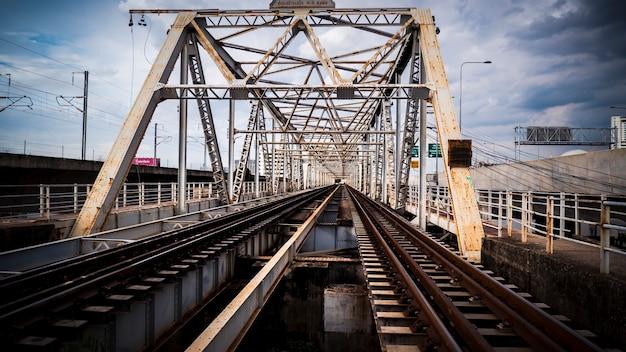 Train trestle bridge over river . the railway bridge of iron.