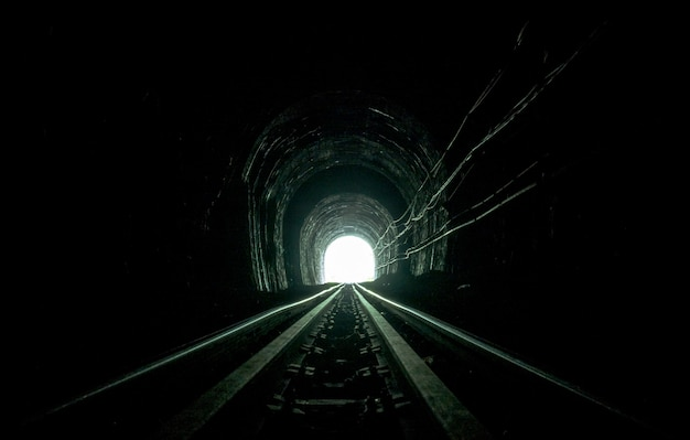 Train tunnel. old railway in cave. hope of life in the end of the way.