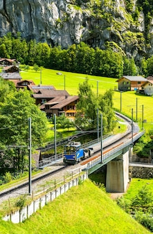 Train on the wengernalp railway, the longest continuous rack and pinion railway in the world. lauterbrunnen, switzerland